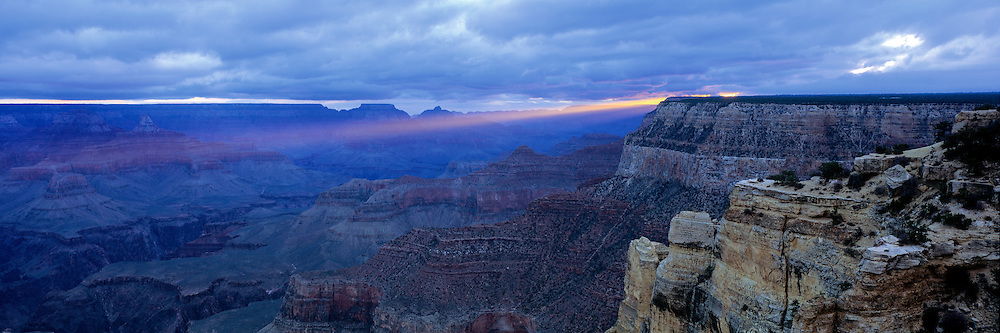 Ray of light from the rising sun viewed from Maricopa Point on the South Rim of the Grand Canyon in Arizona