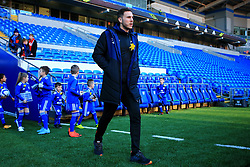 Bournemouth's Dan Gosling inspects the pitch ahead of the match during the Premier League match at the Cardiff City Stadium.