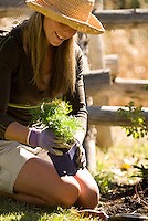 A young woman does gardening work in Jackson Hole, Wyoming.