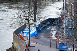 © Licensed to London News Pictures. 26/02/2020. Ironbridge, UK. Flood defences are under threat of collapse in Ironbridge on part of the River Severn, police evacuated part of the town when the flood barriers moved approximately three feet under the strain of the rising water levels. Photo credit: Peter Manning/LNP
