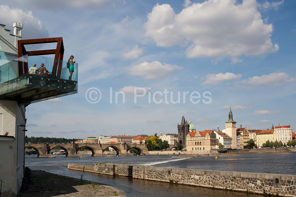 People on the balcony of Kampa Gallery / musuem over looking for the Vltava river, Prague, Czech Republic.  .