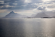Sunshine over sea and mountain scenery Lofoten islands, Nordland, Norway