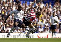 Copyright Sportsbeat Images. 0208 8768611<br />Picture: Henry Browne<br />Date: 3/08/2003<br />Tottenham Hotspur v PSV Eindhoven pre season friendly<br />Mateja Kezman of PSV tries to escape from Spurs' Anthony Gardner