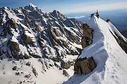 """Zahan Billimoria kicks in a belay platform on the east ride of Buck Mountain during the Exum Mountain Guides """"Live to Ski"""" camp in Grand Teton National Park in Jackson, Wyoming.<br /> (Photo by David Stubbs)"""