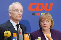 17 JAN 2002, BERLIN/GERMANY:<br /> Edmund Stoiber, CSU, Ministerpraesident Bayern und CDU/CSU Spitzenkandidat, und Angela Merkel, CDU Bundesvorsitzende, waehrend einem Pressestatement zu einer vorangegangenen Besprechung ueber die Organisation des Bundestagswahlkampfes, CDU Bundesgeschaeftsstelle<br /> IMAGE: 20020117-01-008<br /> KEYWORDS: Ministerpräsident, Mikrofon, microphone, Pressekonferenz