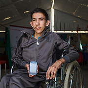 Muhammad, 18, says that the numbers on his phone are the most important thing that he brought with him from Syria. The numbers allow him to communicate with his friends and family who stayed behind.<br /> <br /> Muhammad has severe scoliosis, but is able to attend classes thanks to Mercy Corps' inclusive education program. He learns and participates in activities in this Mercy Corps classroom in Zaatari camp for Syrian refugees, Jordan, May 2015.
