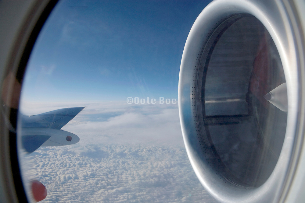 wing and engine of an airplane in flight