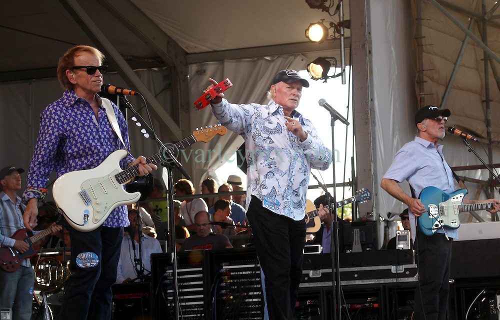 27 April 2012. New Orleans, Louisiana,  USA. .New Orleans Jazz and Heritage Festival. .The Beach Boys take to the stage to kick off their 50th anniversary tour. Al Jardine (L), Mike Love (mid) and David Marks on stage..Photo; Charlie Varley.