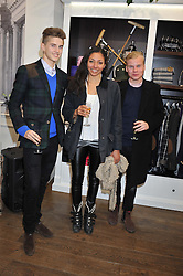 Left to right, MAX BARNES, ZAHRA SUBJALLY and LEO BARNES at the launch party for the Vicomte A boutique in London at 113 King's Road, London SW3 on 13th December 2012.