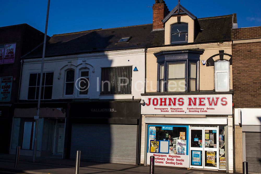 Johns News agents shop in the sunshine in Middlesborough town centre, North Yorkshire, United Kingdom.