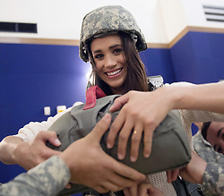 Dec. 7, 2014 - Vicenza, Italy - Actress Meghan Markle is shown how to wear a parachute by the soldiers of the 173rd Airborne Brigade during a holiday visit to service members December 7, 2014 in Vicenza, Italy. The USO tour is for service members deployed outside of the United States during the holidays. (Credit Image: © D. Myles Cullen/Planet Pix via ZUMA Wire)