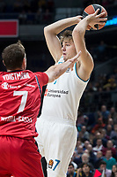 Real Madrid Luka Doncic and Baskonia Vitoria Johannes Voigtmann during Turkish Airlines Euroleague match between Real Madrid and Baskonia Vitoria at Wizink Center in Madrid, Spain. January 17, 2018. (ALTERPHOTOS/Borja B.Hojas)
