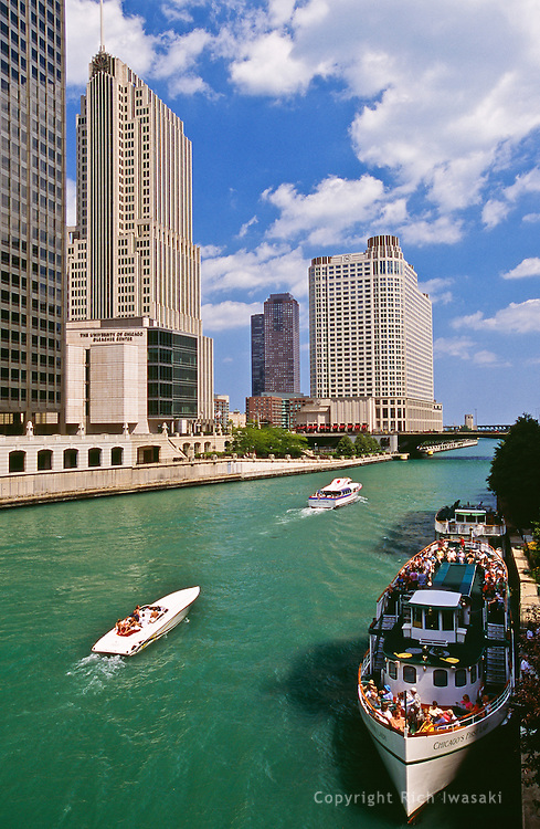 """""""Chicago's First Lady"""" skyline cruise ship (at right), and other tour boats on Chicago River near Michigan Avenue bridge, Chicago, Illinois"""