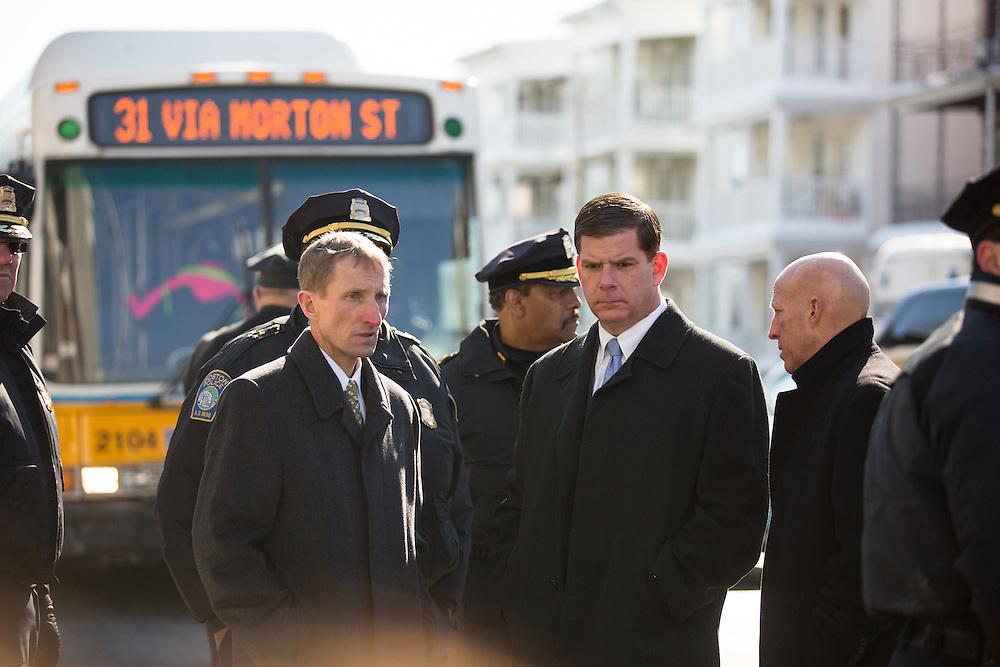Boston, MA 02/07/2014<br /> Boston Mayor Martin Walsh speaks with police officials, including Boston Police Department Commissioner William Evans, at left, on Morton Street on Friday afternoon at the scene of an accidental shooting that killed a 9 year old boy.<br /> Alex Jones / www.alexjonesphoto.com
