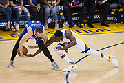 Golden State Warriors forward Draymond Green (23) dives for a loose ball against Philadelphia 76ers guard Nik Stauskas (11) at Oracle Arena in Oakland, Calif., on March 14, 2017. (Stan Olszewski/Special to S.F. Examiner)