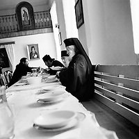Neamt County, Romania, July 2007<br /> Orthodox monks having lunch, after the mass.<br /> Photo: Ezequiel Scagnetti