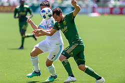 May 13, 2018 - Portland, OR, U.S. - PORTLAND, OR - MAY 13: Portland Timbers midfielder Sebastián Blanco and Seattle Sounders midfielder Cristian Roldan fight for possession during the Portland Timbers 1-0 victory over the Seattle Sounders on May 13, 2018, at Providence Park in Portland, OR. (Photo by Diego Diaz/Icon Sportswire) (Credit Image: © Diego Diaz/Icon SMI via ZUMA Press)