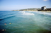 Waves and surfers, San Diego, California, USA
