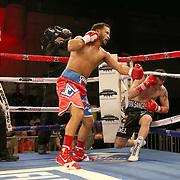 Jose Lopez (L) knocks down Daniel Lopez during a Telemundo boxing match between at Osceola Heritage Park on Friday, February 23, 2018 in Kissimmee, Florida.  (Alex Menendez via AP)