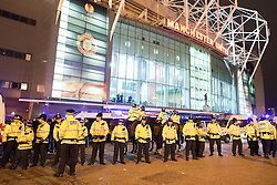 © licensed to London News Pictures. Manchester, UK  23/02/2012. A heavy police presence separates Manchester United and Ajax Amsterdam fans in Manchester ahead of the 2nd leg of the two teams' Europa League tie at Old Trafford. Photo credit should read Joel Goodman/LNP