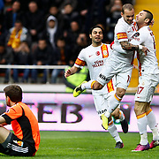 Galatasaray's Burak Yilmaz (R) and Wesley Sneijder (2ndR) celebrate goal during their Turkish superleague soccer match Kayserispor between Galatasaray at Kadir Has Stadium in Kayseri Turkey on Sunday, 17 March 2013. Photo by TURKPIX