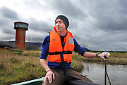 Chris Savage takes tourists for a boat trip among the reeds at the Tralee Wetlands centre which opened to the public at the weekend..Picture by Don MacMonagle