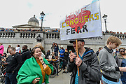 """Anti-lockdown protesters, who believe that the coronavirus pandemic is a hoax, gather at the 'Unite For Freedom' rally in Trafalgar Square in central London on Saturday, Aug 29, 2020. Police officers and members of the press wearing face masks who are monitoring the gathering are often shouted at """"take off the Mask"""". (VXP Photo/ Vudi Xhymshiti)"""