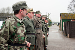 Reenactors portraying German panzer Grenadiers parade for roll call at Eden Camp Malton Nr Pickering<br /> Eden Camp 2012 NWW2A Membership Weekend<br /> http://www.pauldaviddrabble.co.uk<br /> 3  March 2012 <br /> Image © Paul David Drabble