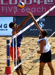 QINZHOU, Oct. 2, 2018  Gao Peng (L) of China competes during the men's Pool A match between Gao Peng/Li Yang of China and Quincy Aye/Arnaud Gauthier-Rat of France at the FIVB Beach Volleyball World Tour in Qinzhou, south China's Guangxi Zhuang Autonomous Region, Oct. 2, 2018. France won 2-0. (Credit Image: © Zhang Ailin/Xinhua via ZUMA Wire)