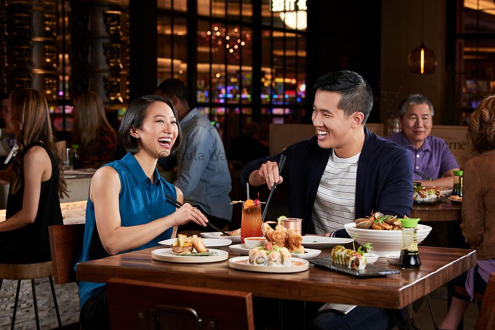 couple enjoying dinner at casino restaurant in California