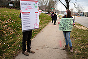 "20 NOVEMBER 2020 - DES MOINES, IOWA: People in front of the Iowa Governor's Mansion protest Iowa's coronavirus response. About 20 people participated in a protest in front of the Iowa Governor's Mansion Friday. They called on Governor Kim Reynolds to immediately issue a comprehensive mask mandate across Iowa. Reynolds, a Republican, has ordered a partial mask mandate that excuses some congregate settings, like classrooms. Iowa has one of the highest per capita COVID-19 infection rates in the country and is dealing with wide ""community spread"" of the Coronavirus (SARS-CoV-2) throughout the state.        PHOTO BY JACK KURTZ"