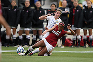 04 December 2011: Stanford's Lindsay Taylor (17) tackles the ball away from Duke's Nicole Lipp (10) in the first half. The Stanford University Cardinal played the Duke University Blue Devils at KSU Soccer Stadium in Kennesaw, Georgia in the NCAA Division I Women's Soccer College Cup Final.