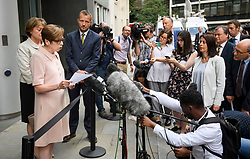 © Licensed to London News Pictures. 18/07/2018. London, UK. FRAN UNSWORTH (second left), Head of BBC News, stands next to JONATHAN MUNRO (third left), Head of Newsgathering, as she reads a statement to media outside the Rolls Building of the High Court in London where judges ruled in favour of a claim by Sir Cliff Richard for damages against the BBC for loss of earnings. The 77-year-old singer sued the corporation after his home in Sunningdale, Berkshire was raided following allegations of sexual assault made to Metropolitan Police. Photo credit: Ben Cawthra/LNP
