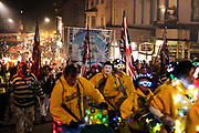 "Lewes Bonfire, describes a set of celebrations held in the town of Lewes, Sussex that constitute the United Kingdom's largest and most famous Bonfire Night festivities. Held on 5 November, the event not only marks Guy Fawkes Night - the date of the uncovering of the Gunpowder Plot in 1605 - but also commemorates the memory of the seventeen Protestant martyrs from the town burned at the stake for their faith during the Marian Persecutions. Lewes is home to the largest and most celebrated of the festivities in the Sussex bonfire tradition. There are seven societies putting on six separate parades and firework displays throughout Lewes on November the 5th. As well as this, 25-30 societies from all around Sussex come to Lewes on the fifth to march the streets. There is a history of religious antagonism and anti-popery around the bonfire celebrations in Lewes. A number of large effigies are drawn through the streets before being burned at the bonfires, these ""Enemies of Bonfire"" range from nationally reviled figures to local officials."