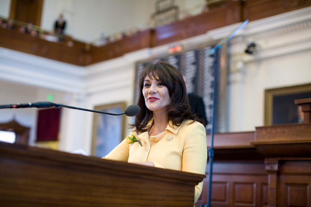 Austin, TX January 13, 2009: First Day of the 81st session of the Texas Legislature on the House floor as Hispanic Rep. Yvonne Gonzalez Toureilles (D-Raymondville) speaks from the front microphone.        ©Bob Daemmrich