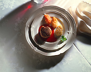Top shot of Fillet of steak & 3 vegetable purees on a white plate & cloth