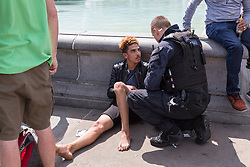 """A police officer from an armed response vehicle arrests an alleged pickpocket in Trafalgar Square after a street performer gave chase, fought with him and restrained him. Street performers demanded that Romanian pickpockets desist from """"working"""" on the North Terrace of Trafalgar Square where they steal from crowds watching the street entertainers. London, August 02 2019."""