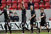 Photo: Kevin Poolman.<br />Swindon Town v Brentford. Coca Cola League 1. 22/04/2006. Callum Wilock (C) and Brentford players celebrate the third goal.