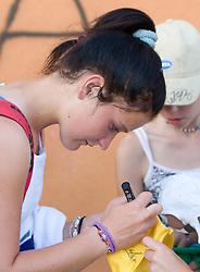 Nastja Kolar of Slovenia with fans after 1st Round of Banka Koper Slovenia Open WTA Tour tennis tournament, on July 21 2009, in Portoroz / Portorose, Slovenia. (Photo by Vid Ponikvar / Sportida)