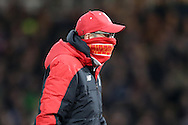 Jürgen Klopp, the Liverpool manager wraps a scarf around his mouth as he looks on. The Emirates FA cup, 4th round replay match, West Ham Utd v Liverpool at the Boleyn Ground, Upton Park  in London on Tuesday 9th February 2016.<br /> pic by John Patrick Fletcher, Andrew Orchard sports photography.