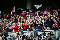 Saracens supporters in the crowd celebrate - Mandatory byline: Patrick Khachfe/JMP - 07966 386802 - 14/05/2016 - RUGBY UNION - Grand Stade de Lyon - Lyon, France - Saracens v Racing 92 - European Rugby Champions Cup Final.
