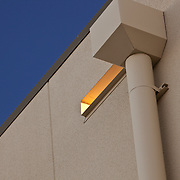 Afternoon sun shines through this portal or spout on an industrial warehouse in American Canyon, CA. Close-up and abstract architectural photography This is an example of Chip Allen's value added service while on the job- we don't miss the details!