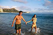 Couple on beach, Waikiki, Oahu, Hawaii