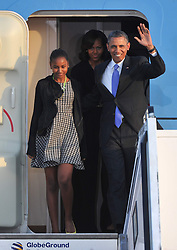 US first lady Michelle Obama, US President Barack Obama and daughters arrive at the military section of Berlin Tegel Airport on June 18, 2013 in Berlin, Germany. Obama is on a two-day visit to Germany where he will give a speech at the Brandenburg Gate, June 18, 2013. Photo by Schneider-Press / John Farr / i-Images. .UK & USA ONLY