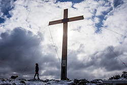© Licensed to London News Pictures. 17/03/2018. Otley UK. The 36ft Otley Chevin Cross has been placed in position this morning at Otley Chevin in Yorkshire. The Cross will stay in place throughout the Easter period, an Easter Sunday service will be held at the foot of the cross on Sunday April 1st. Photo credit: Andrew McCaren/LNP