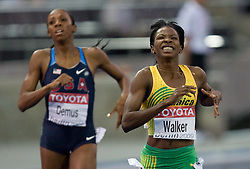 Melaine Walker (R) of Jamaica reacts when winning the gold medal in the women's 400 Metres Hurdles Final during day six of the 12th IAAF World Athletics Championships at the Olympic Stadium on August 20, 2009 in Berlin, Germany. (Photo by Vid Ponikvar / Sportida)