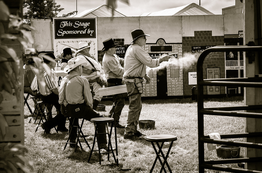Men participate in an old fashioned fast draw competition. Photo by Adel B. Korkor.