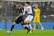 Tottenham Hotspur forward Son Heung-Min (7) battles for possession with Inter Milan midfielder Marcelo Brozovic (77)during the Champions League group stage match between Tottenham Hotspur and Inter Milan at Wembley Stadium, London, England on 28 November 2018.