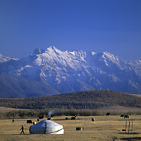 MONGOLIA, Darhad Valley.  A nomadic family's ger (yurt) pitched in temporay pastures below Horidal Saridag Mountains.