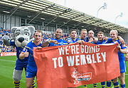 Warrington Wolves players celebrate during the Ladbrokes Challenge Cup Semi-Final  match Warrington Wolves -V- Wakefield Trinity Wildcats at , Leigh, Greater Manchester, England on Saturday, July 30, 2016. (Steve Flynn/Image of Sport)